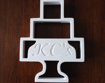 Personalized wedding cake cookie cutter.