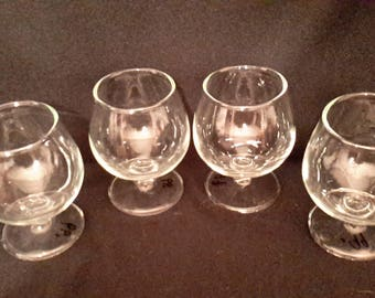 Four clear crystal brandy snifters
