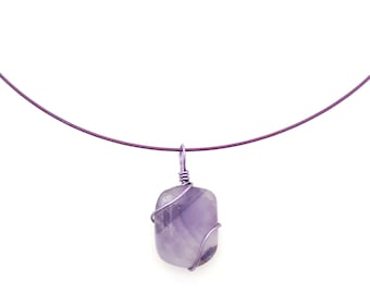 Lilac stone necklace worn at the neck.