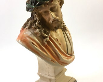 Vintage plaster chalk ware bust of Jesus Christ's passion with crown of thorns sits on pedestal base