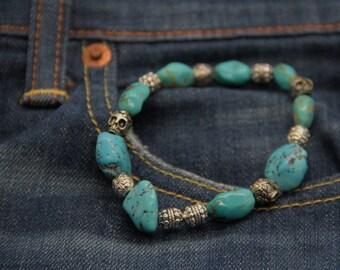 Mens turquoise bracelet and silver skulls fashionable. Blue rebel