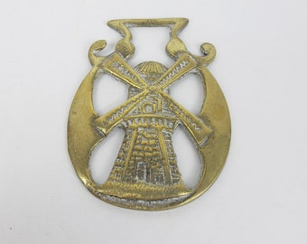 Vintage horse brass. Dutch style windmill.