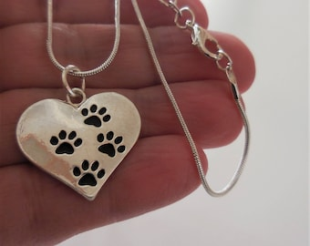 Silver paw print heart necklace, girls, ladys pet lovers, cats dogs, animals. Pets leave paw prints on our hearts.