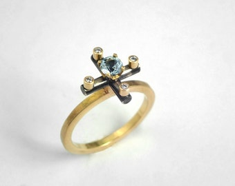 The gold cross ring. An alternative 18K solid gold engagement ring decorated with an aquamarine stone and diamonds, Unique engagement ring.