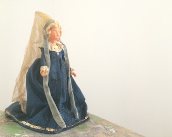 Old doll, blue dress.