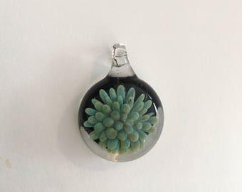 Handmade blue glass flower pendant