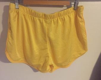 Bright yellow sports shorts, size XL
