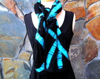 Nuno felt scarf on black silk with a turquoise abstract line design