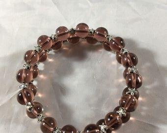 Purple beaded bracelet with stars