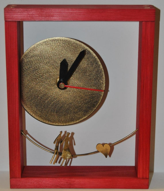 Desk clock with deep red wooden frame.
