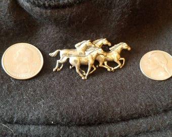 Equestrian pin wild horses running