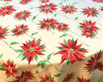 "Vintage Christmas tablecloth with poinsettias in cotton or cotton blend in very good to excellent condition, 68"" X 52"""