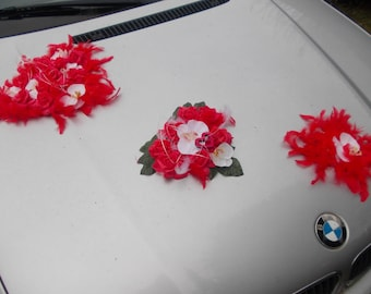 Red and white wedding car decoration