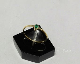 18 carat gold and faceted emerald engagement ring
