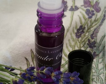 Lavender Essential Oil with a purple roller ball applicator