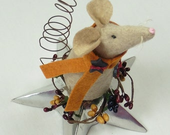 Handmade Wool Felt Mouse Sitting on a Silver Star