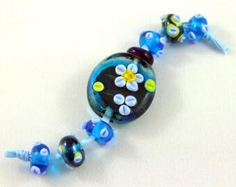 lampwork bead set, focal glass bead, set of 7 beads, blue glass beads, floral glass beads, SRA beads, textured glass beads, designer beads