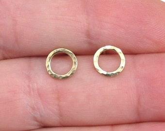 Small circles 14k solid gold earrings.Hoop  Post  Earrings. Hammered  stud earrings .  posts and studs are solid gold .65 dollars only