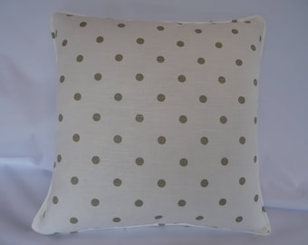 Polka dot taupe and off-white cushion cover.