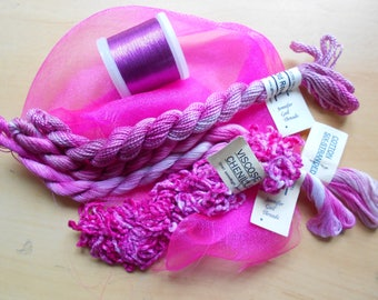 Selection of hand and machine threads with small piece of organza to match.