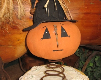 Sing a song of Halloween - primitive jack-o-lantern on a rusty spring