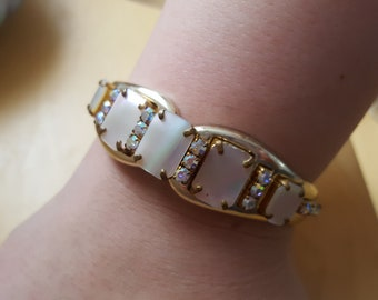 Gold coloured metal bangle MOP shell
