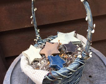 Rustic wicker basket with rustic wooden stars