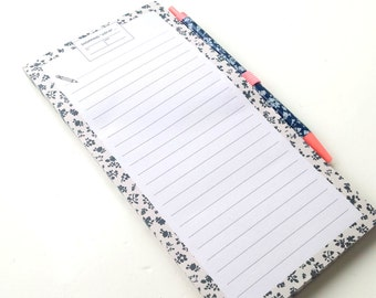 Shopping list notepad with magnetic backing and matching pen