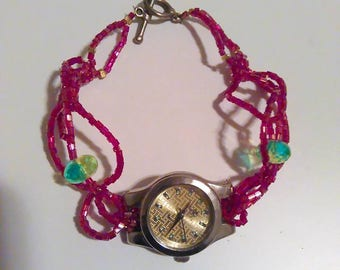 Womens red & lime green glass braided watch