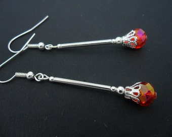 A pair of pretty long red crystal   bead   dangly earrings.