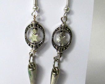 Sister, silver stars, spears, bead frame,textured, metals sculptural,  handmade, contemporary. steampunk