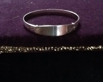 Childs silver bangle.