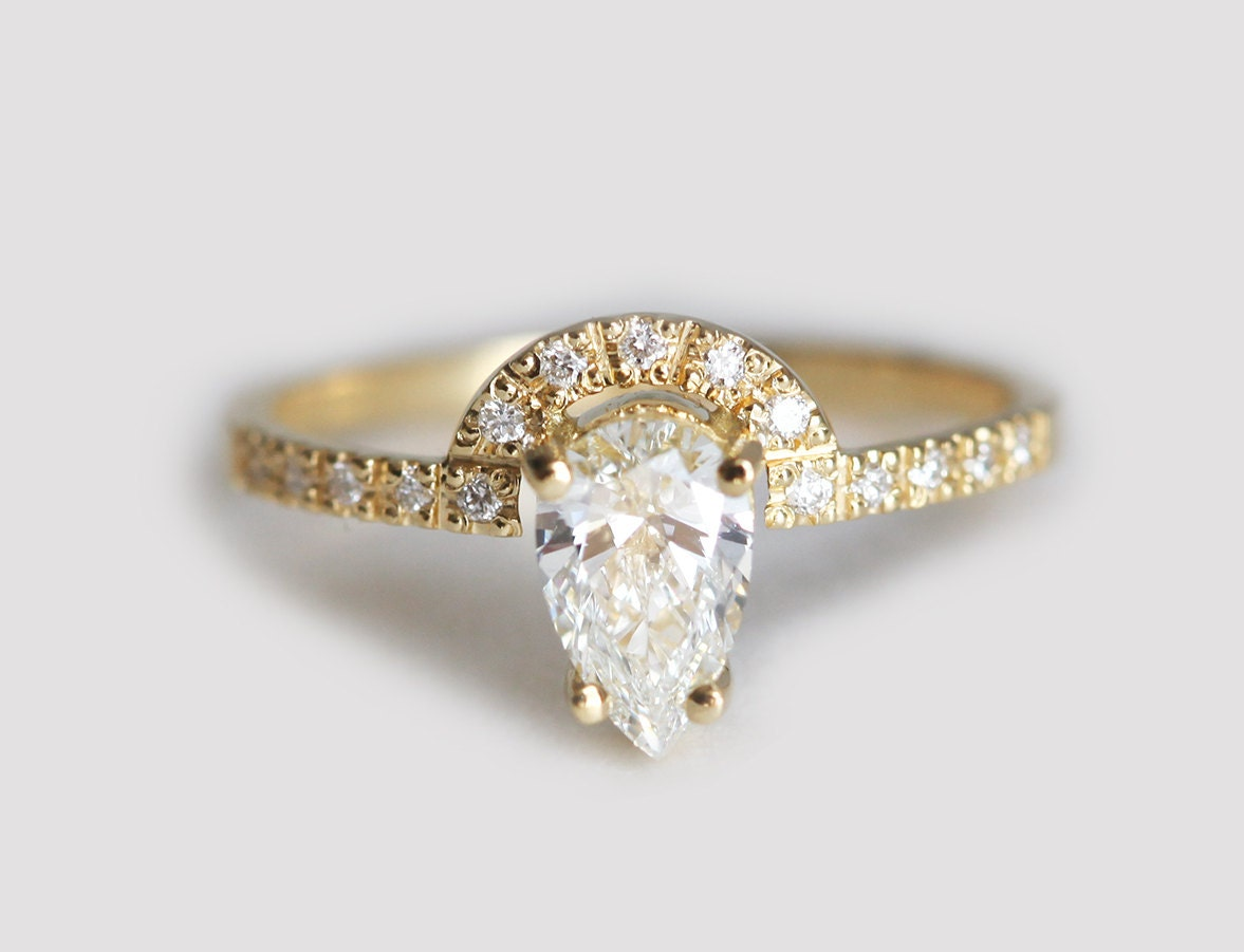 in gold rockher ring halo shank with shape pave elevated white diamond wedding engagement rings pear