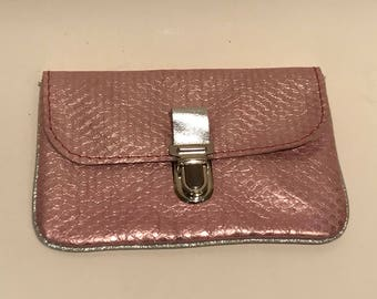 Cowhide leather clutch in pale pink and silver piping