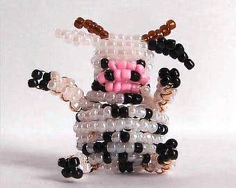 Miniature cow with seed beads and copper wire