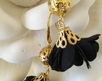 Black flower dangle earrings with a sparkle bead and gold plated hoop!
