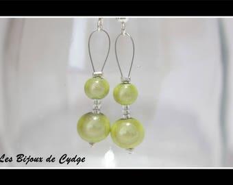 Earrings and pale green magic beads