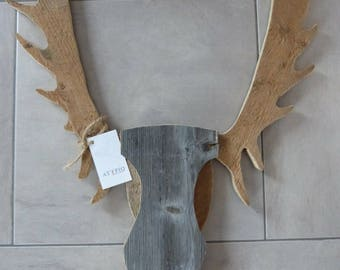 White roe deer on recycled wooden frame