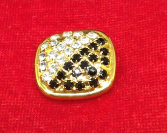 Gold, black and white Jewel button.