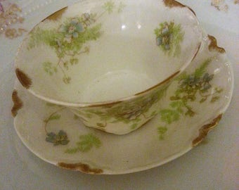 Stunning antique Haviland Limoges France tea cup and saucer with blue flowers and gold trim, original maker's mark, perfect condition