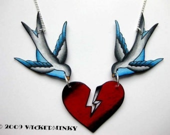 vintage tattoo style sparrows holding broken blood red heart necklace with silver plated chain
