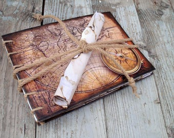Travel photo album scrapbook, feather pen, depiction of compass, ancient map for your honeymoon epic trip, pirate photo book, recycled paper