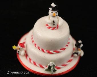 12th Scale Handmade miniature snowman cake.