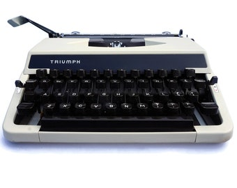 Typewriter For Writing! Vintage Triumph Typewriter in great working condition. A Classic Mid Century Modern Typewriter from the 1970s
