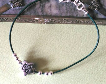 SMILEY bracelet: silver charm on  leather cord