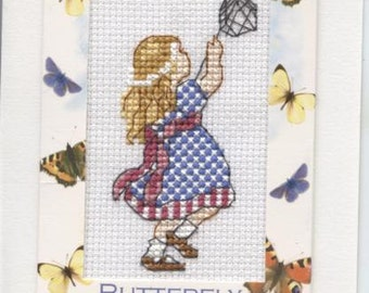 Greetings card with girl catching butterflies design