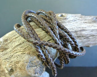 20 centimeters of braided leather cord Brown dark 5 mm in diameter, first layer of synthetic leather