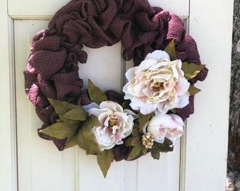 Beautiful purple burlap & flowers. Simple elegance that will last man
