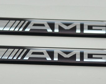 2x MERCEDES AMG Logo 3D Domed Stickers. Size 60x10mm.