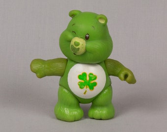 Good Luck Care Bear, Poseable Care Bear, 1983, Tummy with 4 leaf clover, Head arms legs move, Sits and stands, Green Care Bear
